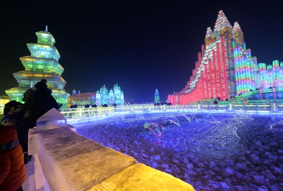 "Visitors gather at the China Ice and Snow World, after the official opening of the 15th Harbin International Ice and Snow Festival in Harbin, in northeast China's Heilongjiang province on January 5, 2014. Thousands of visitors braved temperatures of minus 27 degrees Celsius (-17 degrees Fahrenheit) to visit the Ice and Snow World, which features the theme ""Global Ice and Snow Dream, World Cartoon Tour"". AFP PHOTO/GOH CHAI HINGOH CHAI HIN/AFP/Getty Images"